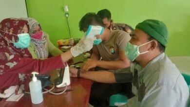 Polres Natuna Salurkan Sembako dan Suntik Vaksin di Desa Sepempang